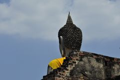 Buddha statue rises above an ancient temple`s walls Royalty Free Stock Photos