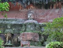 Buddha statue in the rock stock photo