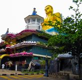 Buddha statue on the roof of the temple in Dambulla, Sri Lanka. stock photo