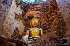 Buddha statue ruined by earthquake. Royalty Free Stock Image