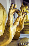 Buddha statue's hand Generally in Thailand. Any kinds of decorated in Buddhist church, etc. they are public domain of Buddhism. Selective focus And Close up Royalty Free Stock Photography