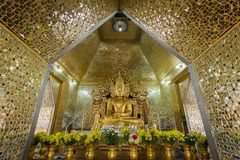 Buddha statue at Sandamuni Pagoda in Mandalay. Front view of a golden statue of Buddha in lotus position inside the Sandamuni Pagoda in Mandalay, Myanmar Burma Stock Photography