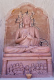 Buddha Statue at Sarnath. Sarnath is the deer park where Gautama Buddha first taught the Dharma, and where the Buddhist Sangha came into existence through the Stock Photo