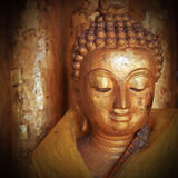 Buddha statue sculpture with golden face Stock Image