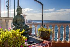 Buddha statue on seaside. Buddha statue on open terrace cafe Stock Image