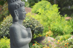 Buddha statue seating in the park and meditating Stock Photo