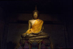 Buddha statue in shadow Royalty Free Stock Photo