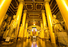Buddha statue in  Shwedagon Pagoda at dusk (Yangon, Myanmar) Stock Photo