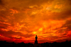 Buddha statue in Silhouette scene at sunset Stock Photo
