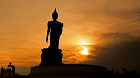 Buddha statue in Silhouette sunset scene at Phutthamonthon Stock Image