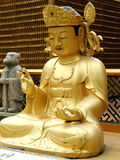 Buddha. Statue sitting at the entrance to a Buddhist monastery Royalty Free Stock Photos