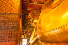 Lying down Buddha statue in Wat Pho temple , Bangkok, Thailand Royalty Free Stock Images