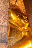 Lying down Buddha statue in Wat Pho temple , Bangkok, Thailand Stock Photo