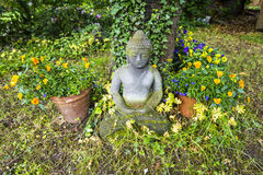 Buddha statue in sitting position Royalty Free Stock Image