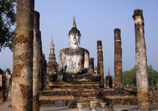 Buddha statue sitting among the ruins of Sukhothai Stock Images