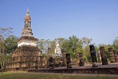 Buddha statue sitting among the ruins of Sukhothai Stock Photos