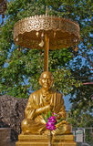 Buddha statue sitting in the umbrella Stock Images