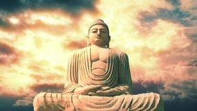 Buddha Statue And Sky In Vibrant Beautiful Colors. Huge stone statue of the Buddha in meditating position with amazing sky stock video footage