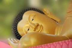 Buddha statue smiley face. Budha statue laying with smiling face Stock Image