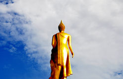 Buddha statue soars into sky. Golden Buddha statue soars into sky at Wat Moli in Nonthaburi province of Thailand Stock Photos