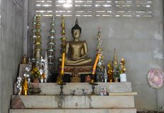 The buddha statue and some worship  sacrifice in old room at t. The buddha statue and some worship Royalty Free Stock Photos