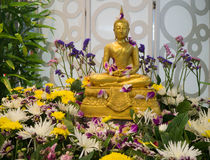 Buddha Statue Songkran Festival in Thailand. Buddha statue covered with flower for Songkran in Thailand Stock Image