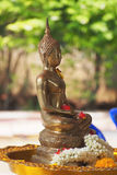 Buddha statue in Songkran festival. Water festival Royalty Free Stock Photo