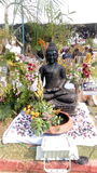 Buddha statue. Spruce up with colourful flowers, pleasant environment get q stock image