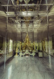 Buddha statue in stainless steel temple Stock Photos