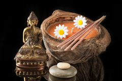 Buddha statue, stone massage and incense sticks Royalty Free Stock Images