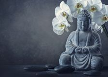 Buddha statue and stones. On a black background stock photography