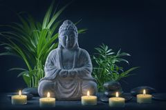 Buddha statue and stones. On a black background stock photo