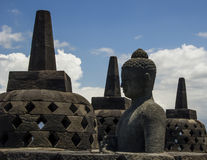 Buddha statue and stupas. Borobodur temple. Buddha statue and stupas. Borobodur temple, Jogyakarta, Indonesia Royalty Free Stock Photography