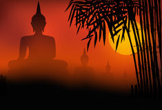 Buddha statue sunset. And bamboo as foreground Royalty Free Stock Photography