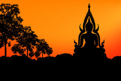 Buddha statue sunset. On the mountain and tree as foreground stock illustration