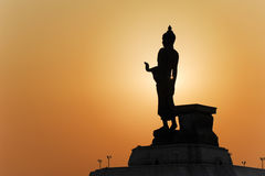 Buddha statue and the sunset. Buddha statue ,other attractions of the town Buddha is very beautiful Places extensive and well organized Stock Photo