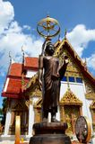 Buddha statue with sunshade outside temple Hat Yai Thailand. Hat Yai, Thailand - December 24, 2015: A life size statue of the holy Buddha stands near the front Stock Photos
