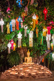Buddha statue surounded by candles during Loy Kratong Festival, Stock Photo