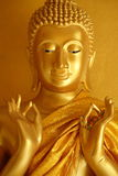 Buddha statue in a teaching gesture. A golden Buddha statue in a teaching gesture on Magha Puja Day Stock Images
