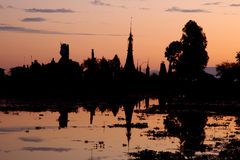 Buddha statue and temple. During sunset on a lake Stock Image