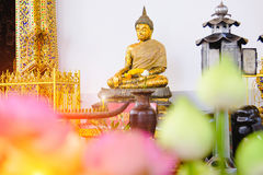 Buddha statue with thai art architecture in front church Wat Suthat temple. Stock Photography