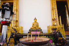 Buddha statue with thai art architecture in front church Wat Suthat temple. This is a Buddhist temple in Bangkok Stock Image