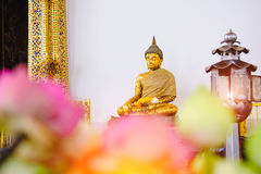 Buddha statue with thai art architecture in front church Wat Suthat temple. This is a Buddhist temple in Bangkok Stock Photography