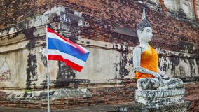 Buddha statue and Thai flag in the temple Royalty Free Stock Photos