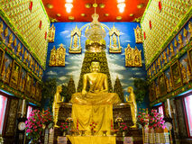 Buddha statue in Thailand church with stucco around. Royalty Free Stock Images