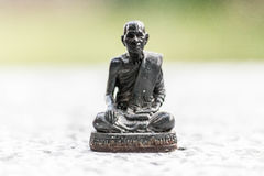 Buddha statue. A title given to the founder of Buddhism, Siddartha Gautama  circa 563– circa 460 bc  . Born a prince in what is now Nepal, he renounced wealth Stock Image