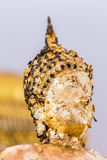 The Buddha statue to gild with gold leaf. Which people use to worship the buddha image. Selective focus stock images