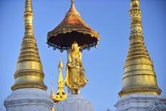 Buddha statue on top of pagoda around Shwedagon Pagoda - Yangon, Stock Photography