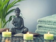 Buddha statue ,towels and candles. On a black background stock photography