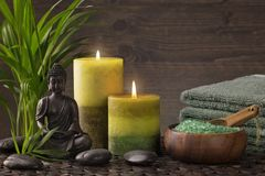 Buddha statue ,towels and candles. On a brown background stock photo
